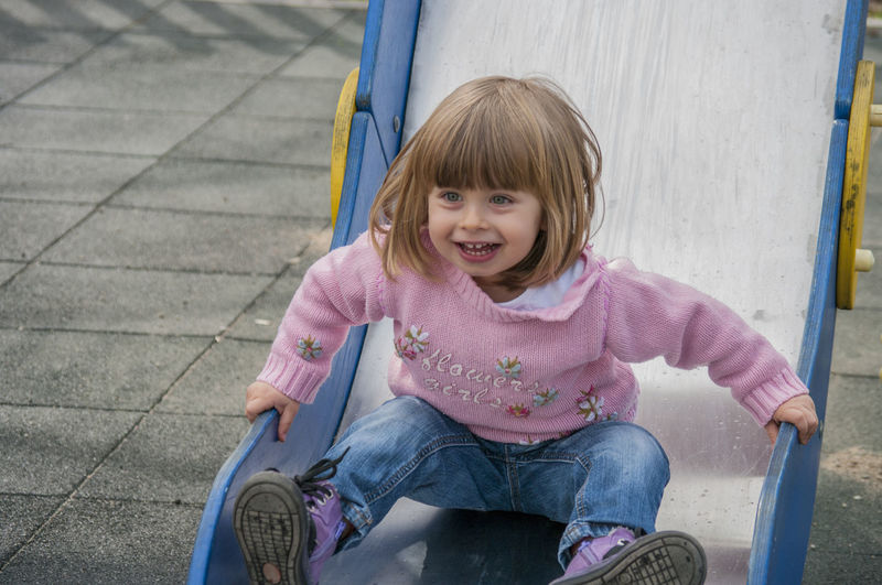 Happy girl at playground outdoors