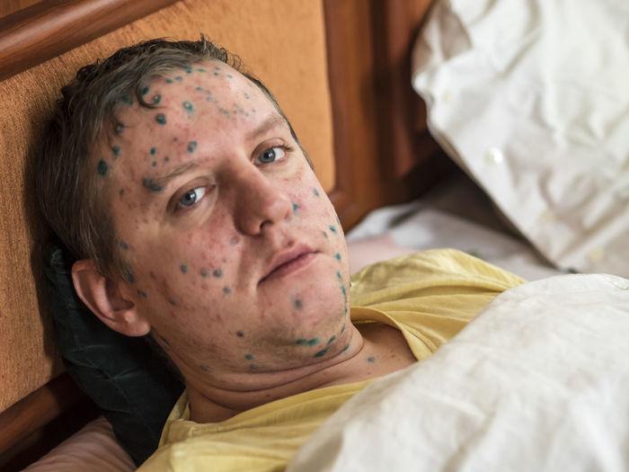 Portrait of man lying in bed
