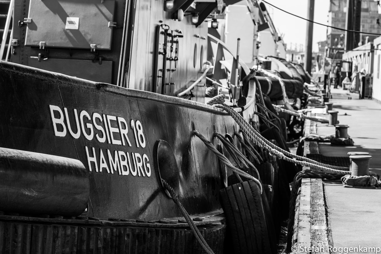 transportation, mode of transport, nautical vessel, text, outdoors, day, real people, city
