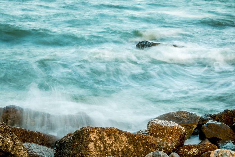 Wave on the rock. Beautiful seascape. Gran View Island, Fox Hill, Hampton, Virginia Beauty In Nature Blue Day Long Exposure Motion Nature No People Outdoors Rock - Object Sea Stones Water Wave White Waves