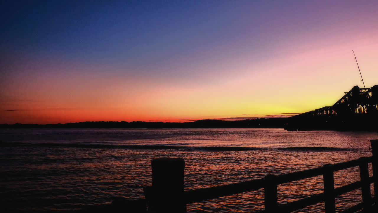 sunset, sky, water, beauty in nature, scenics - nature, tranquility, orange color, tranquil scene, sea, silhouette, nature, copy space, no people, railing, clear sky, idyllic, architecture, outdoors, land
