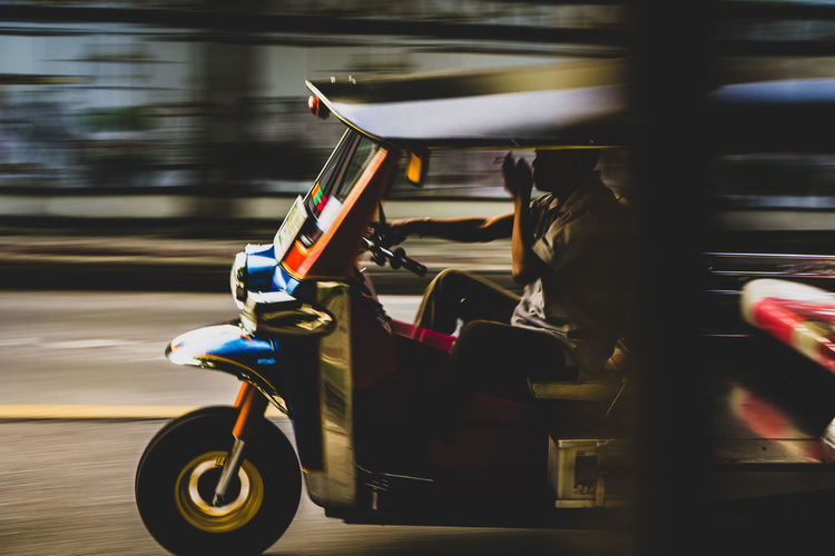 """""""Need for speed: Bangkok"""" - Tuktuk speeds by. Thailand Transportation Unique Transportation 3 Wheels Driving By Smoking - Activity Smoke And Drive Tuktuklife 1 Person Thailand_allshots Thailandstyle Thai Style Thaistyle TukTuk Panningphotography Panning Need For Speed Tuktuk Driver Tuktuk Thailand Tuktuklovers Tuktuk Streets Bangkok Thailand. Bangkok EyeEm Thailand Vehicle Photography Fast Speed Blurred Motion Vehicle Moving Land Vehicle"""
