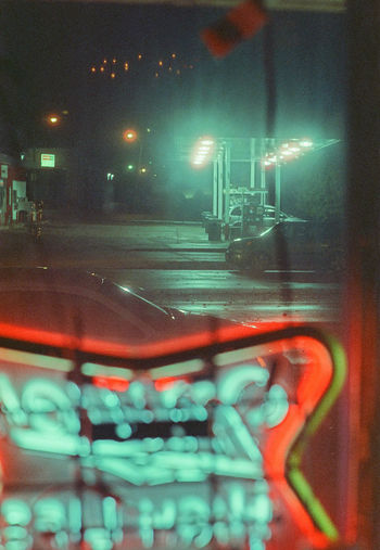 Lonely Nights Bar City Lights City Lights At Night City Night Eerie Eerie Beautiful Illuminated Lights In The Dark Lonely Looking Out Of The Window Neon Lights Neon Sign Night Nightlife No People Urban Window Window View 35mm Film Analogue Photography Analog