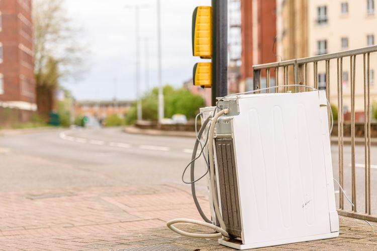 Abandoned Washing Machine or Tumble Dryer on English Street Road Machine Road Washing Abandoned Dryer  England Street Sustainability Traffic Light  Tumble Used Utility
