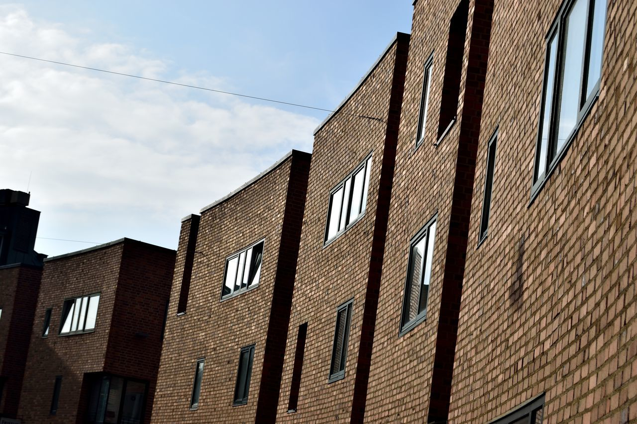 building exterior, low angle view, architecture, built structure, brick wall, sky, day, window, no people, outdoors