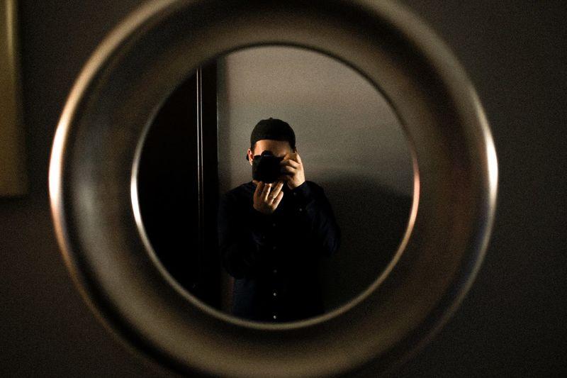 Mirror self portrait of professional photographer minimal