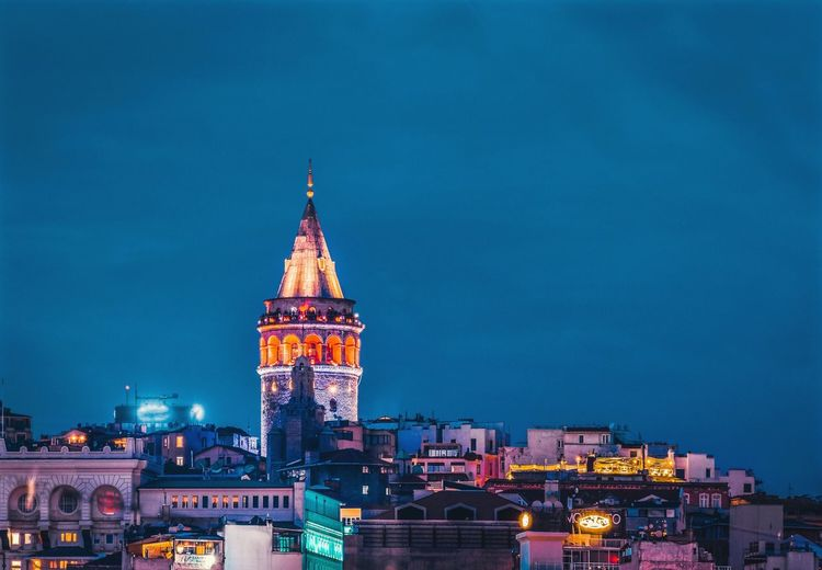 Galata Tower in Istanbul AArchitecturebBuilt StructurenNightCCityCCityscapenNo PeopletTravel DestinationsGGalata TowerCCityscapegGalatavVibrant ColorbBluehourffirst eyeem photo