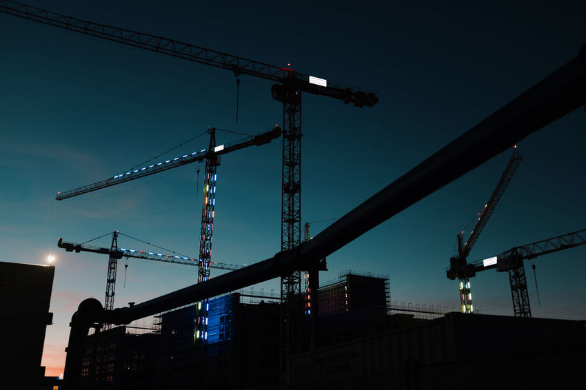SIM CITY AT NIGHT Architecture Built Structure City Construction Equipment Construction Industry Construction Site Crane - Construction Machinery Development Dusk Illuminated Incomplete Industrial Equipment Industry Low Angle View Machinery Nature No People Outdoors Silhouette Sky Tall - High Twodayscologne