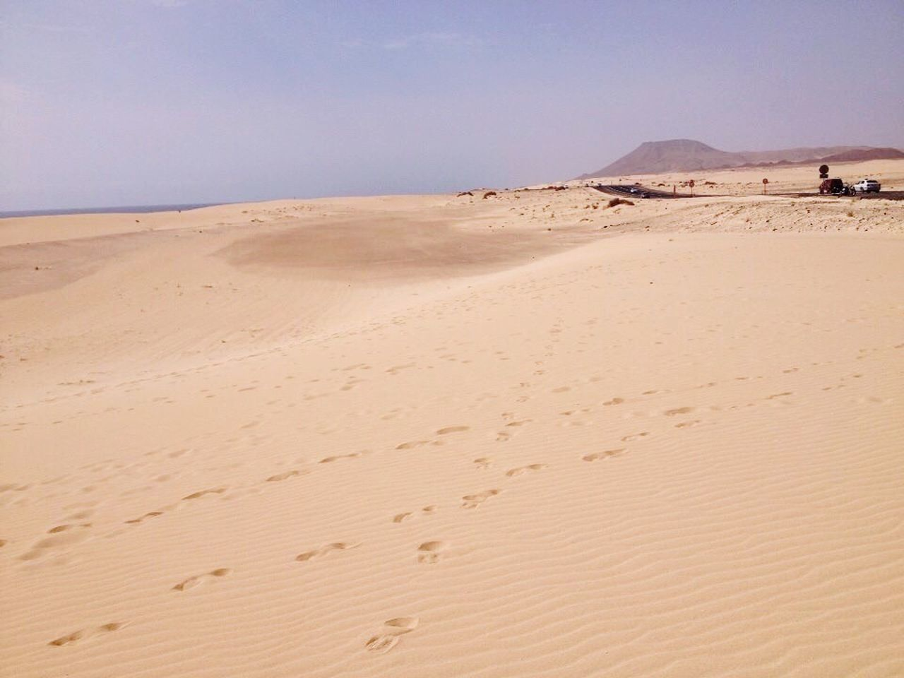 sand, beach, sand dune, desert, nature, arid climate, shore, scenics, beauty in nature, tranquil scene, landscape, day, tranquility, outdoors, sea, clear sky, sky, no people