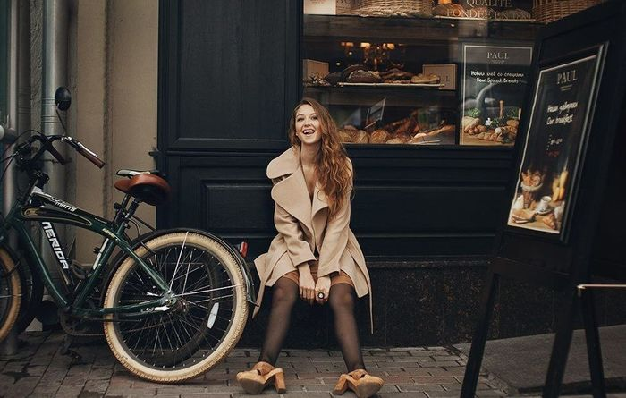 Casual Clothing Confidence  Cross-legged Day Front View Full Length Happiness In Front Of Leisure Activity Lifestyles Looking At Camera Mature Adult Mode Of Transport Outdoors Person Place Of Worship Portrait Smiling Spirituality Standing Transportation Young Adult Young Women
