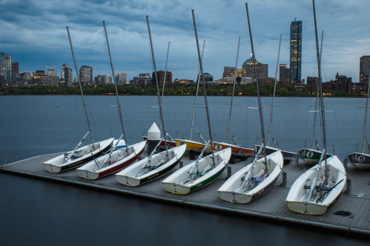 Sailboats moored in river