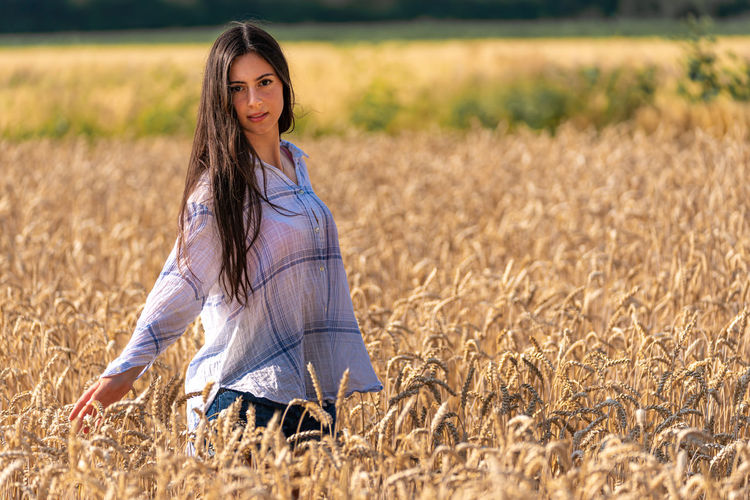Young woman in the cornfield