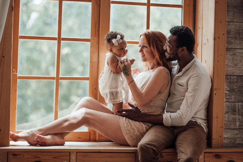 Couple sitting on window