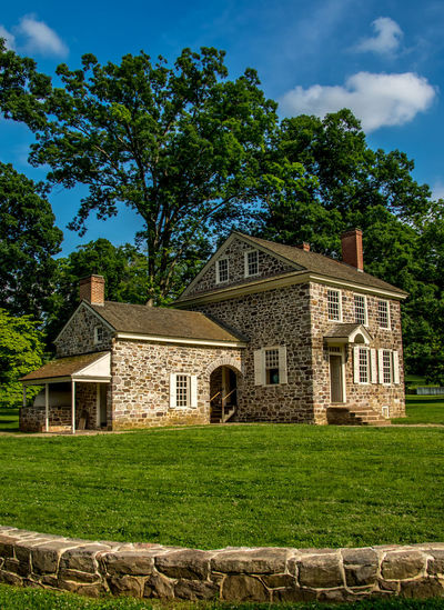 This is a photo of George Washington's Headquarters in Valley Forge National Park. While there are many building in Valley Forge National Historical Park that are original to the time of the encampment, none holds more historical significance than Washington's Headquarters. For most of the six-month encampment, Washington made his home in this stone building, meeting with advisers as they made plans, not only for the encampment, but the continuation of the war. Architecture Built Structure Cloud Cloud - Sky Day Exterior EyeEm Best Shots Façade George Washington Grass Grassy Green Green Color Growth Headquarters Historical Building Lawn Nature No People Outdoors Plant Revolutionary War Sky Travel Destinations Tree