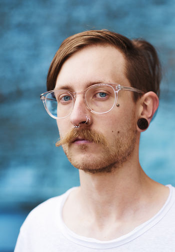 Young men wearing eyeglasses Blue Close-up Day Eyeglasses  Eyes Focus On Foreground Glasses Leipzig Lifestyles Looking At Camera Men Moustache One Person Outdoors Portrait Real People Young Adult Young Men This Is Masculinity
