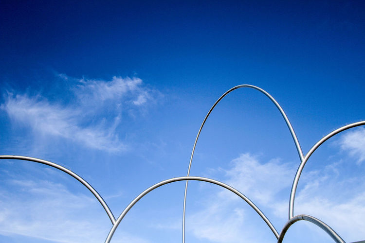 Low Angle View Of Metal Fence Against Sky