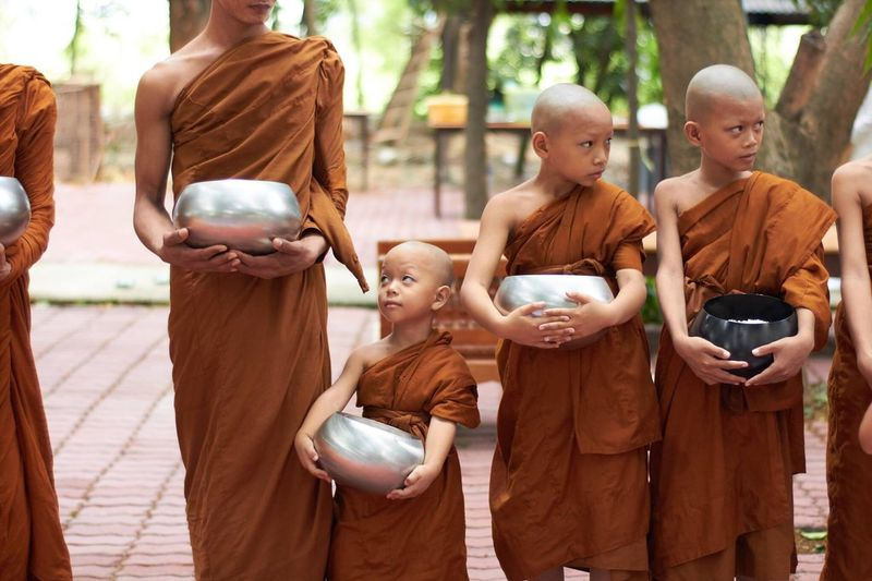 Little monk waiting for donation. Men Togetherness Monk  Children Little Cute Donation Buddhism Religion Woreship Mercy  Thai Peaceful