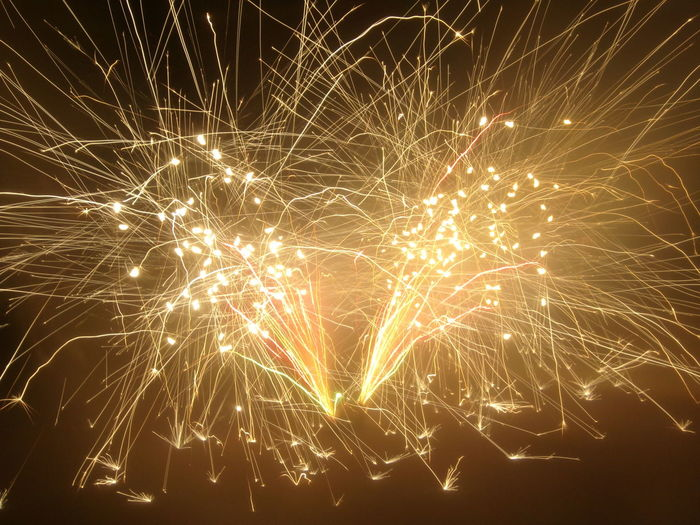 Close-up of fireworks against sky at night