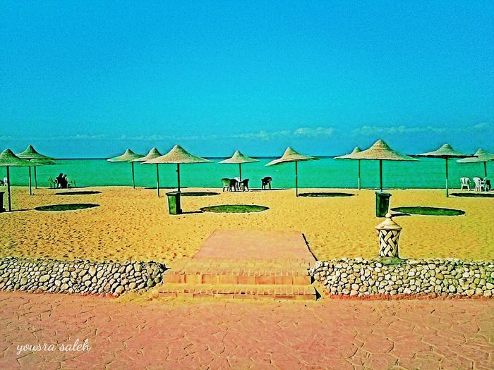 Colour Of Life Here Belongs To Me Beach Beach Photography Sea Seascape Sea And Sky Golden Sand Sand Nature Nature_collection Tranquility Naturelovers Beach Umbrellas Umbrellas Relaxing Relaxing View Last Summer Colorful Taking Photos Seaside Sea View Ras Sudr Egypt Smartphonephotography Love To Take Photos ❤ 10Oct_2015 Live For The Story