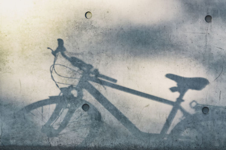 Close-Up of Soft Shadow of Bicycle on Wall Berlin Germany 🇩🇪 Deutschland Color Image Horizontal Outdoors No People Shadow Bicycle Transportation Mode Of Transportation Sunlight Land Vehicle Day Wall - Building Feature Focus On Shadow Wheel Close-up Concrete Wall Cycling Abstract Concepts Grey Lifestyle Healthy Lifestyle