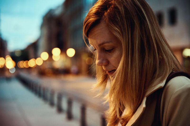 Woman at night city street