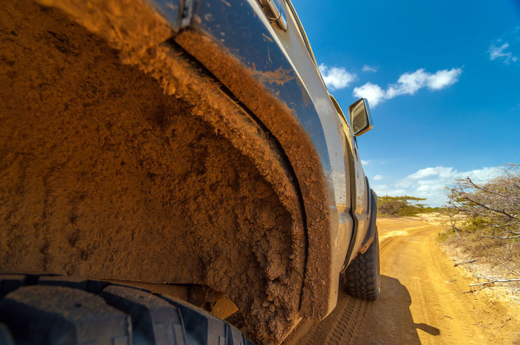 Muddy dirty wheel well on an SUV in a desert Adventure America Arid Automobile Car Colombia Countryside Dirt Dirty Drive Guajira Muddy Outdoors Road Sand South Summer SUV Texture Tire Transport Transportation Vehicle Well  Wheel