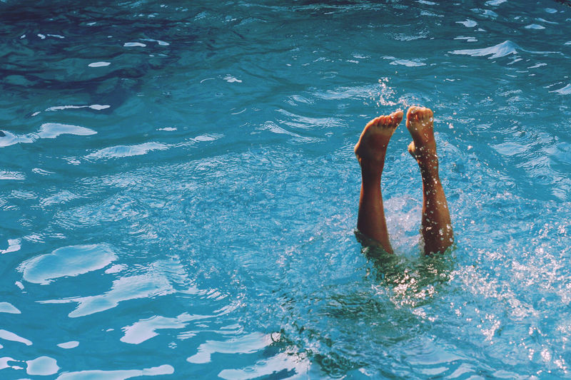 Upside down image of person in swimming pool