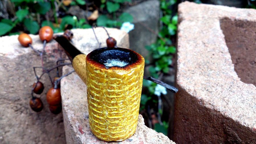 at times, the smoking apparatus doesn't look out of place in the Environment. Smoking Pipe Smoking Nature