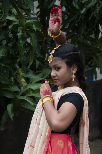 Young woman practicing dance in nature