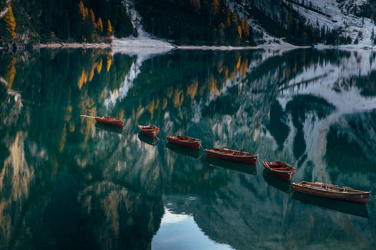 Braies Lake Braies Lake Dolomites Landscape Waterscape Italy Dolomiti Travel Travel Photography Traveler Alps Mountain Sunset Boats Water Scenics - Nature Beauty In Nature Nature Light Autumn Season  Refflections Colors Colors Of Autumn Tourism Destination National Park