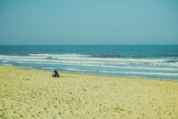 Sea Beach Water Horizon Horizon Over Water Land Sky Scenics - Nature Beauty In Nature Clear Sky Nature Tranquil Scene Tranquility Outdoors Beach Photography Sand Space For Text Space For Copy Motion Leading Lines Real People One Person Day Lifestyles