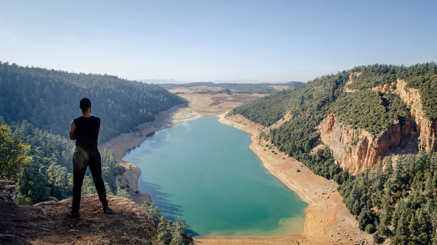 Hiking man looking at aguelmam azigza lake