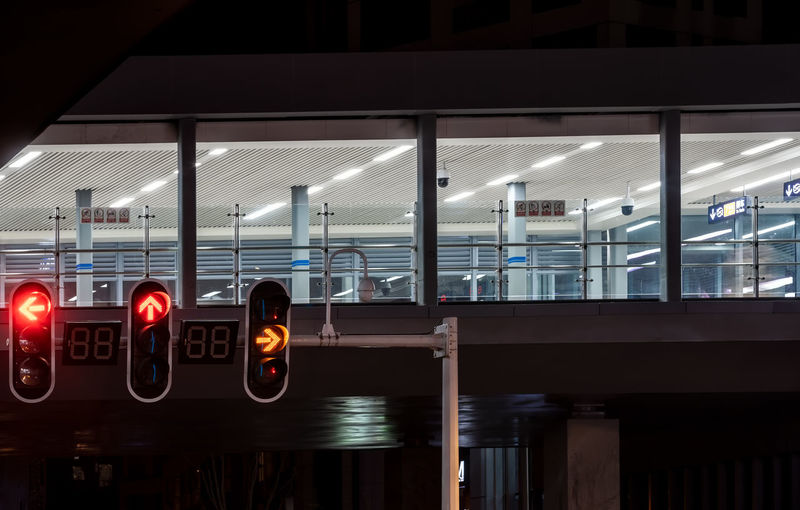 Illuminated Sign Transportation Communication Glass - Material Guidance Architecture Built Structure No People Transparent Red Light Building Exterior Travel Text Mode Of Transportation Light Stoplight Reflection Outdoors Modern Architectural Column