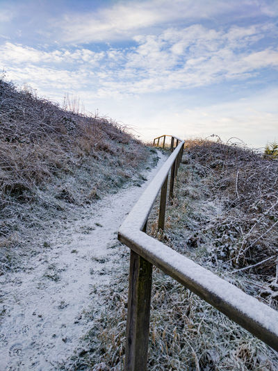 going up hill Footpath Uphill Going Up Wales UK Railing Brambles Snow Snow Cold Temperature Winter Sky Cloud - Sky Frozen Frost Weather Condition Cold Snow Covered