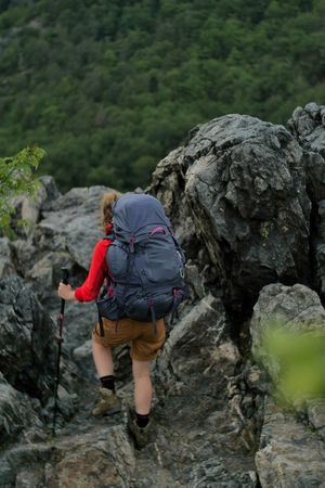 female hiker walking on a trail Alpine Backpacking Camping Expedition Freedom Hiking Nature Travel Trekking Woman Active Activity Adventure Backpack Boot Climbing Detail Female Full Length Healthy Lifestyle Hiking Hobbies Legs Leisure Activity Lifestyles Mountain Nature One Person Outdoors People person Real People Rear View Recreational Pursuit Rock Rock - Object Solid Sport Trek Walking