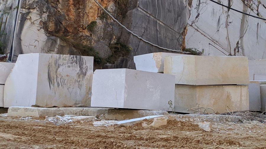 White wall by rocks on field