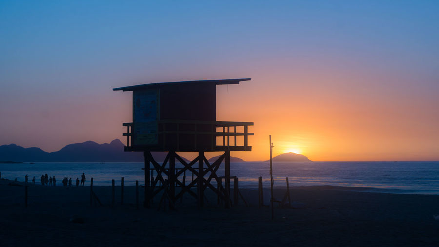 Architecture Beach Beauty In Nature Built Structure Enjoying Life Enjoying The Sun Enjoying The View Lifeguard Hut Nature No People Orange Color Outdoors Protection Sea Sky Sunrise Tranquil Scene Tranquility Water