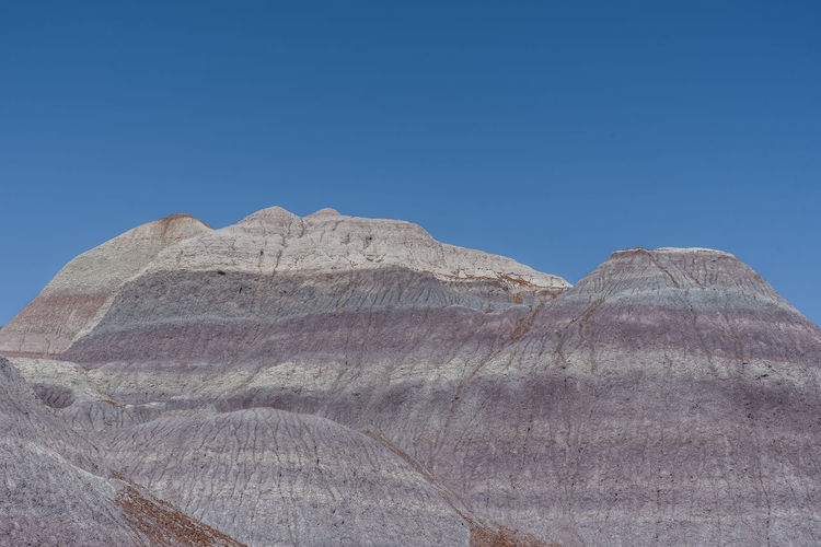Landscape of large purple and white badlands in petrified forest national park in arizona