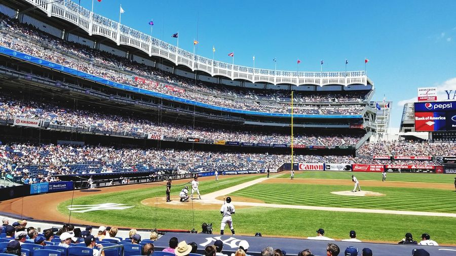 Grass Sport Stadium Yankees large group of people Playing Field Team Sport Real People Outdoors Baseball - Sport Blue Sports Team People Sky Day Spectator Crowd Fan - Enthusiast