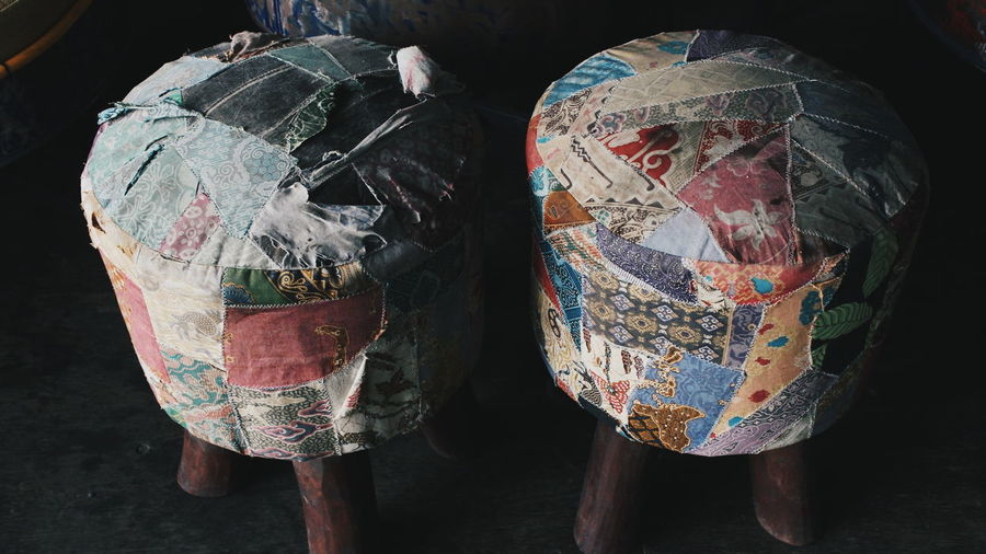 High angle view of stools made from old fabric and wood