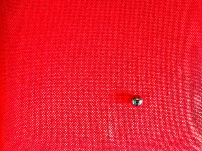 Close-up of pin on bulletin board