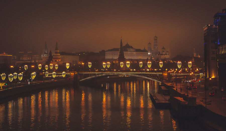 Illuminated bridge over river against sky at night, moscow