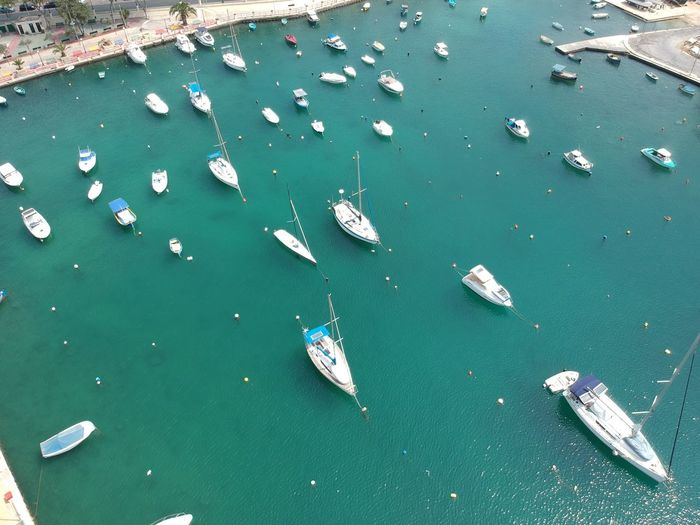 High Angle View Of Sailboats Moored On Sea