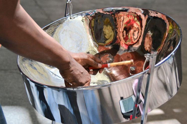 Cropped image of man with solar cooker