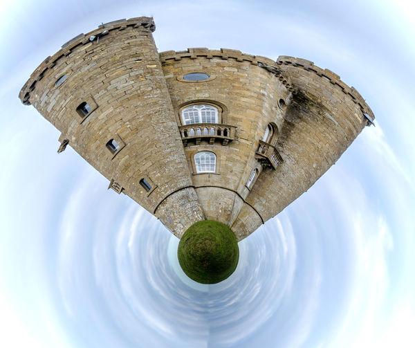 Digital composite image of historic building against sky