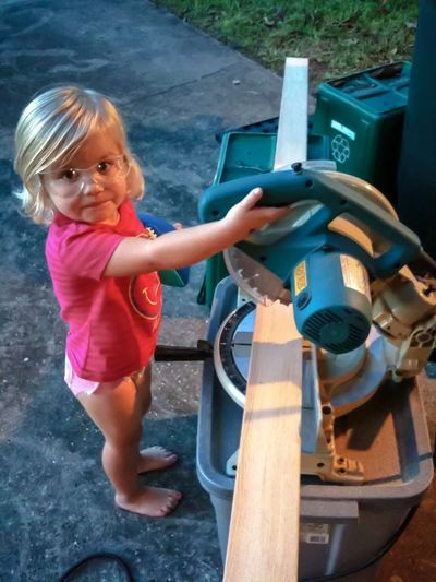 Helping Dad Blonde Childhood Chopping Wood Elementary Age Full Length Girls Happiness Holding Looking At Camera Miter Saw Person Portrait Working Hard The Portraitist - 2016 EyeEm Awards Power Tools Working Hard Helper EyeEmNewHere
