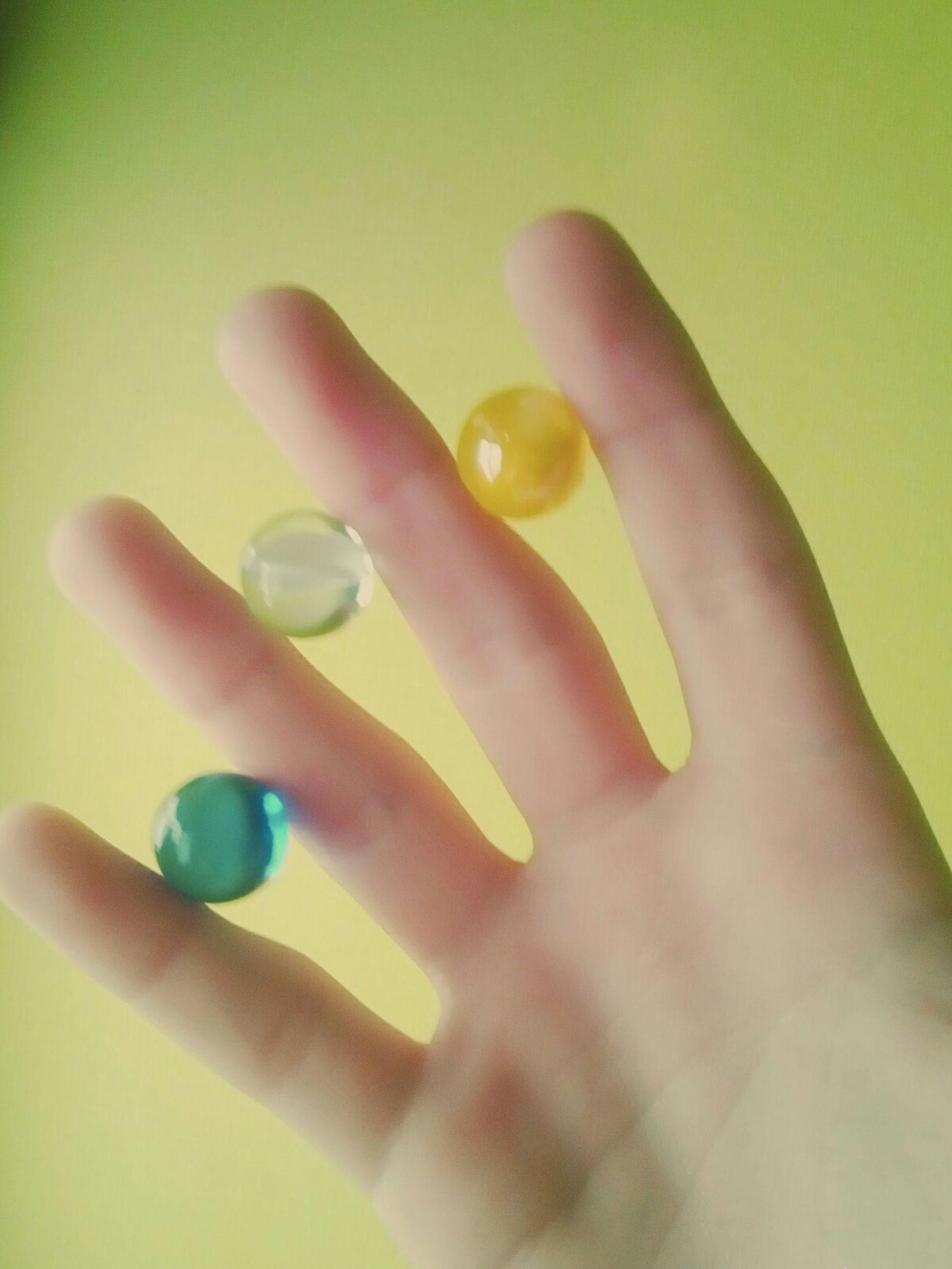 indoors, person, lifestyles, holding, part of, leisure activity, childhood, human finger, close-up, cropped, yellow, high angle view, toy, home interior, unrecognizable person, nail polish