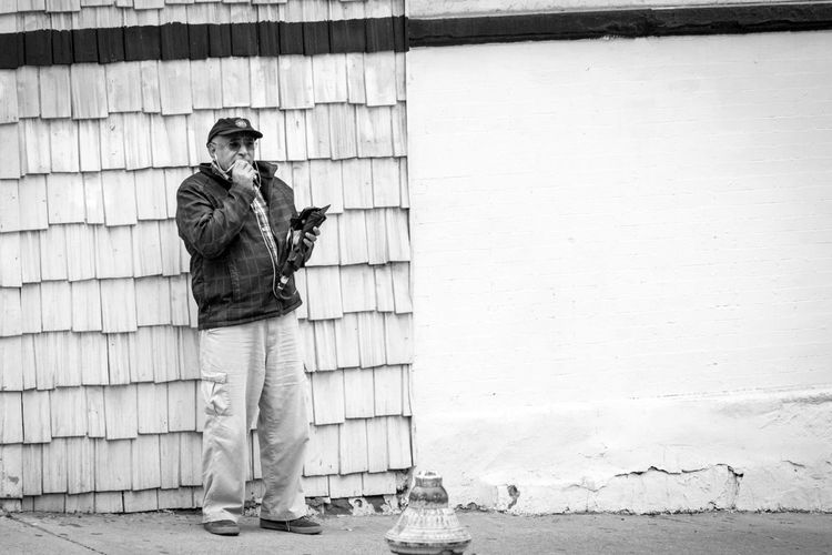 Roger, roger... Blackandwhite Built Structure City Life Conversation Hat Outdoors Phone Streetphotography