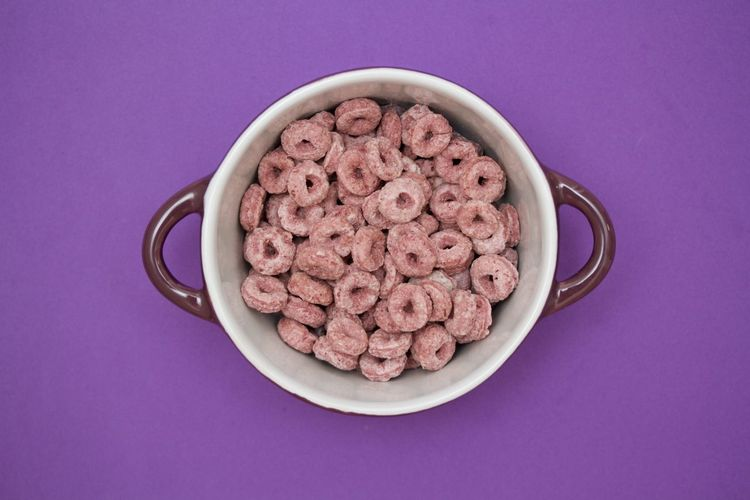 purple frootloops in a purple bowl on purple background Bowl Breakfast Cereal Directly Above Food No People Purple Purple Background Studio Shot