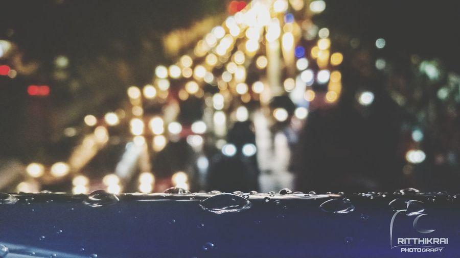 Close-up of wet illuminated car at night